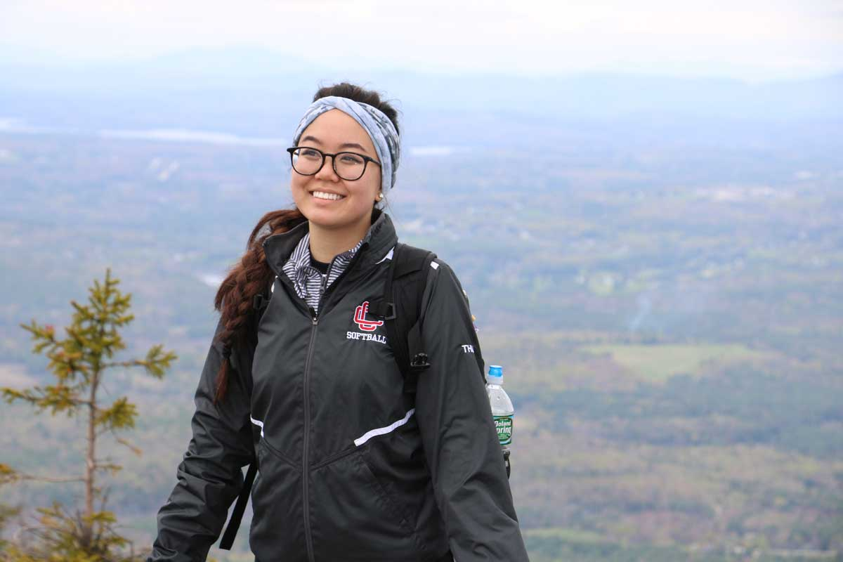 Hiker climbs Mount Kearsarge with the Outdoor Adventure Club.